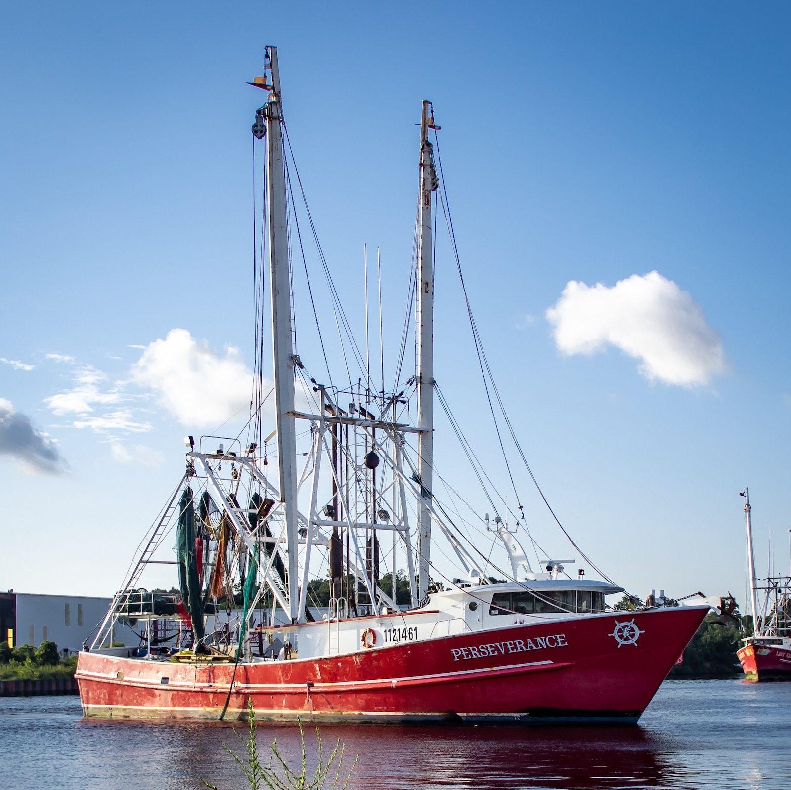 Shrimp boat coming into port in Bayou La Batre, AL