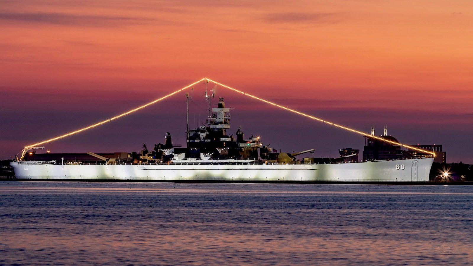 USS Alabama after sunset
