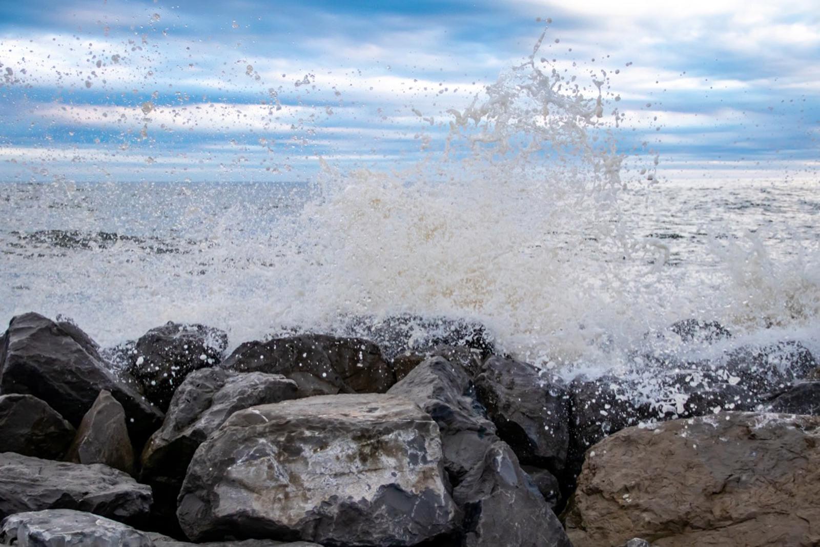 Waves crashing on jetty at Dauphin Island, AL